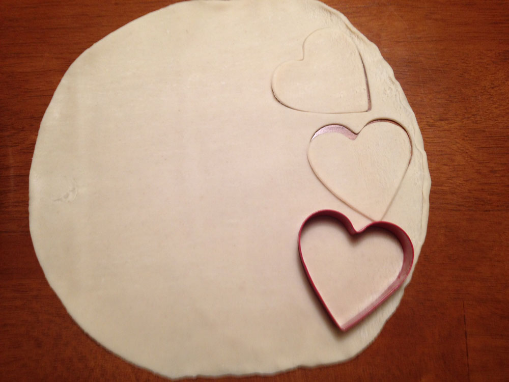 Cut out hearts from dough